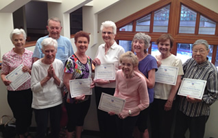 TLC Yoga Graduation: Smiles Say It All